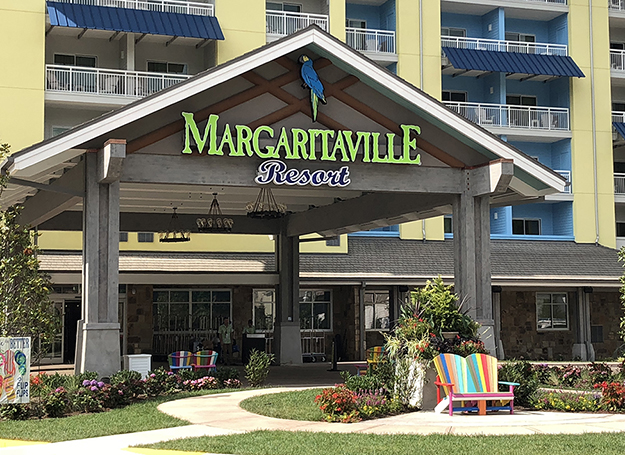 Tropical resort lands in the middle of a mountain river for Margaritaville hotel decor